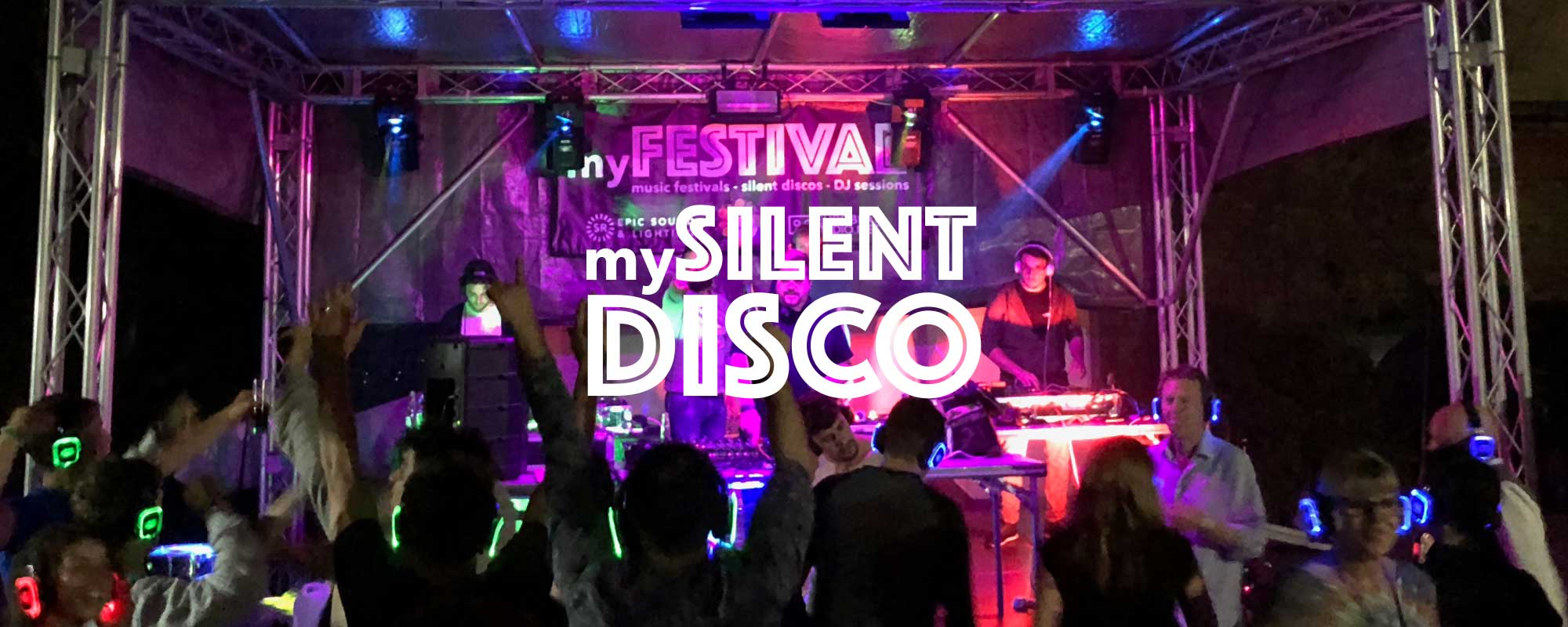 Outdoor silent disco with DJs on stage